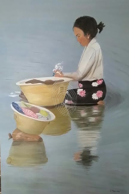 Burmese Woman Washing Clothes in the River