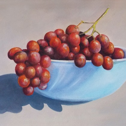 'Red grapes and blue bowl'