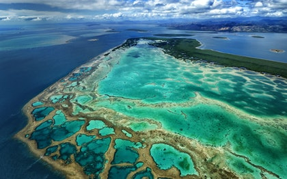 (CreativeWork) Coral reef and islands by Stuart Chape. photograph. Shop online at Bluethumb.