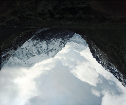 A mountain valley, shows upside down