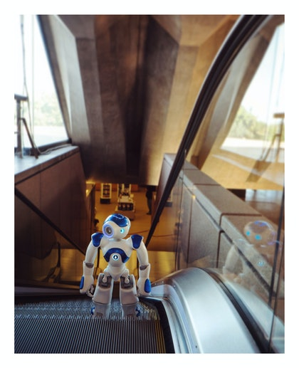 (CreativeWork) Robot Usher - Escalator by Alex Weltlinger. photograph. Shop online at Bluethumb.