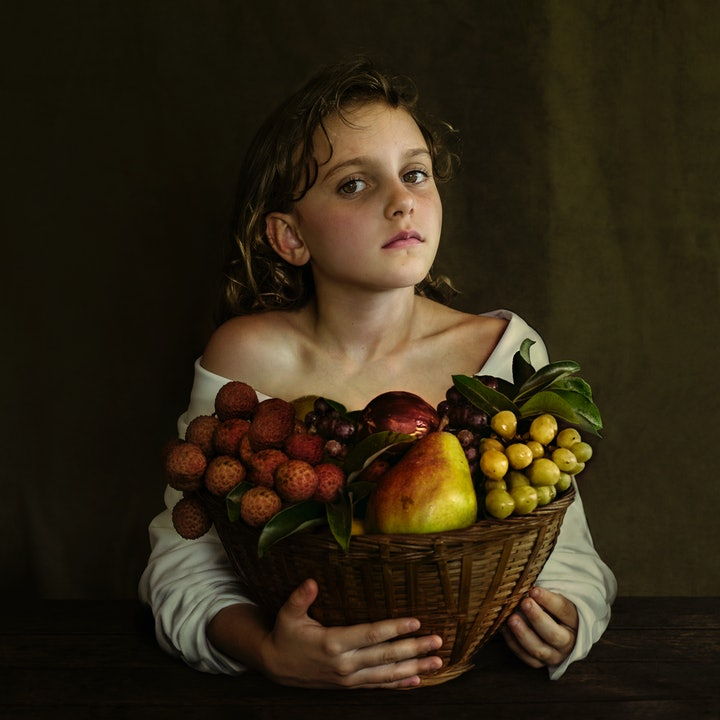 (CreativeWork) Girl with a Basket of Fruit by Dasha Riley. photograph. Shop online at Bluethumb.