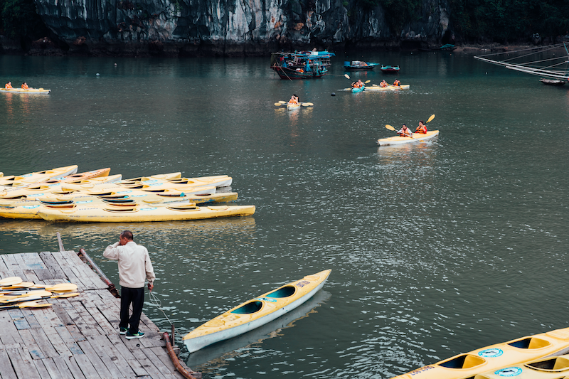 (CreativeWork) Kayaks in Ha Long Bay by Megan George. photograph. Shop online at Bluethumb.