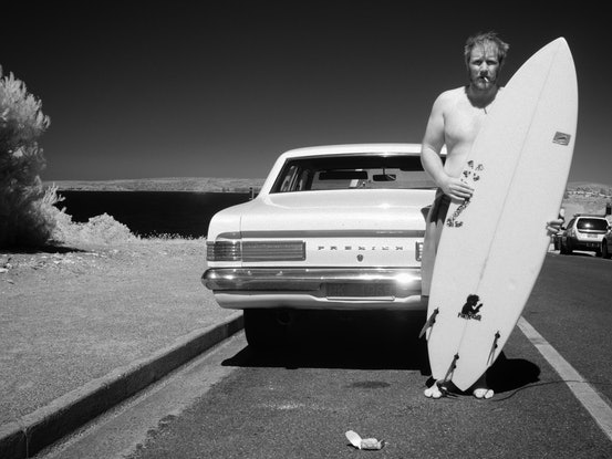 (CreativeWork) Surfer with Holden Ed. 1 of 1 by Alex Frayne. Photograph. Shop online at Bluethumb.