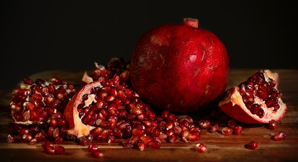 (CreativeWork) Pomegranates by Anna-Riitta Ovaska. photograph. Shop online at Bluethumb.