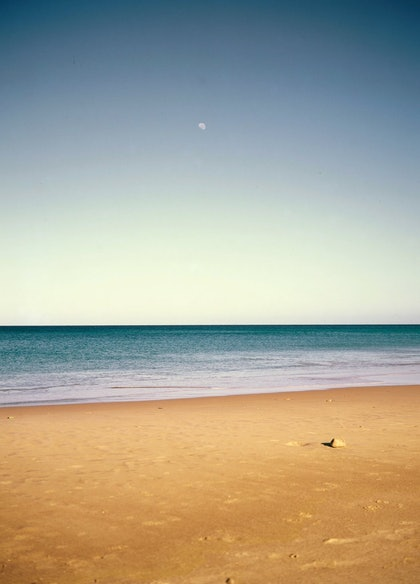 (CreativeWork) MOON, SKY, SEA, SAND, ROCK - MASLIN BEACH, SA by Tony Knight. photograph. Shop online at Bluethumb.