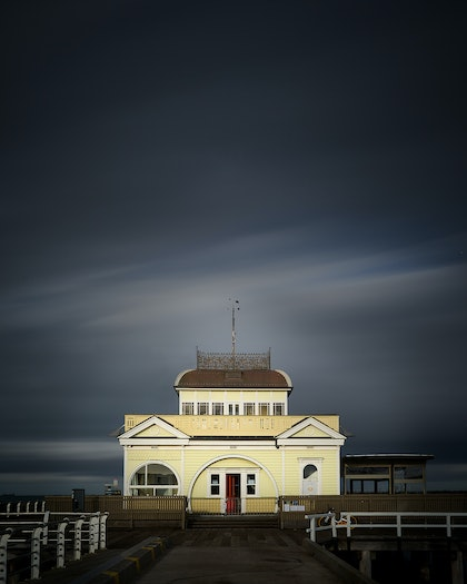 (CreativeWork) Yellow House, Red Door, Grey Sky by Simon Ng. photograph. Shop online at Bluethumb.