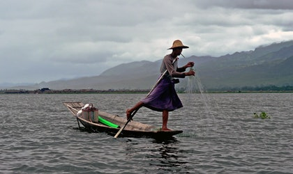 (CreativeWork) FISHERMAN - LAKE INLE, MYANMAR by Tony Knight. photograph. Shop online at Bluethumb.