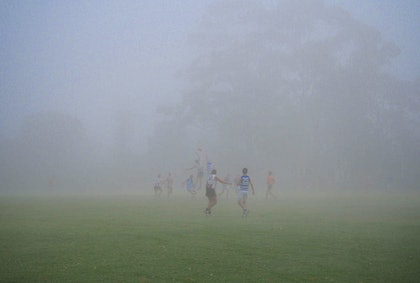 (CreativeWork) foggy footy by Peter Collie. photograph. Shop online at Bluethumb.