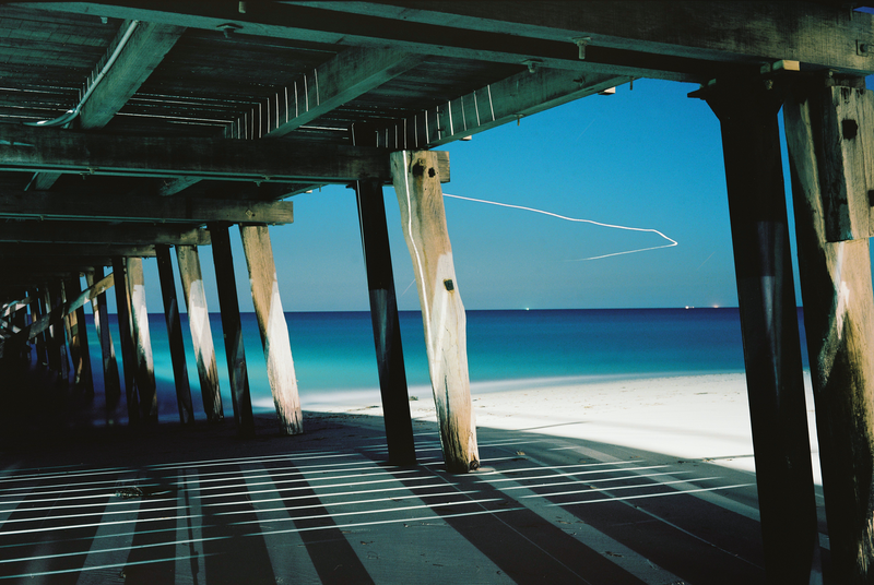 (CreativeWork) Aeroplane Over Jetty by Alex Frayne. photograph. Shop online at Bluethumb.