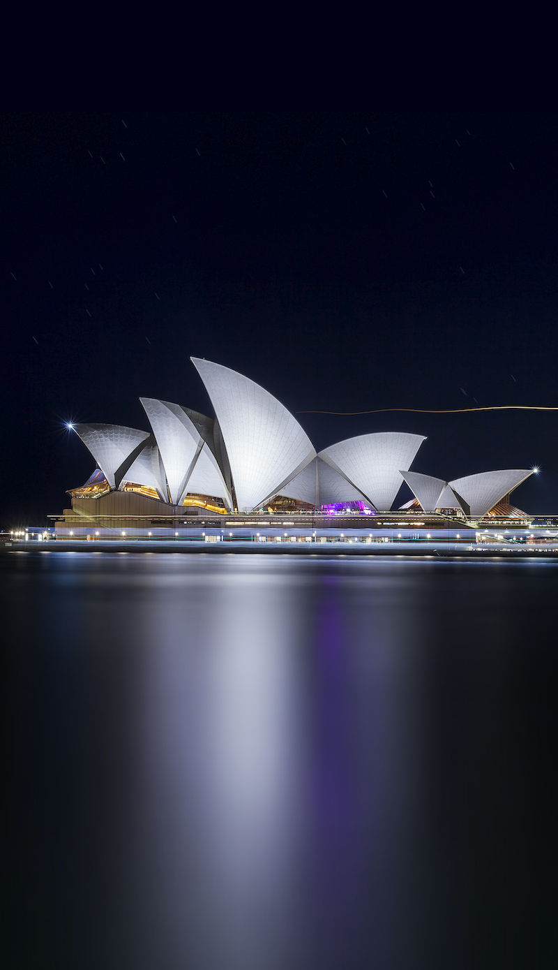 (CreativeWork) Sydney Opera House and ferry lights by Piers Buxton. photograph. Shop online at Bluethumb.