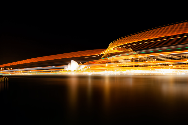 (CreativeWork) Sydney Opera house and  a large ferry passing by Piers Buxton. photograph. Shop online at Bluethumb.