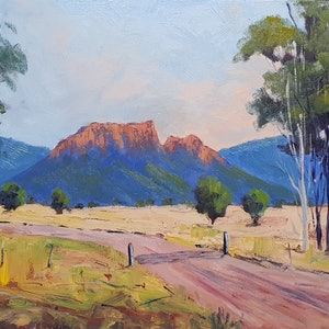(CreativeWork) Approach To Mt Walsh by Rod Moore. oil-painting. Shop online at Bluethumb.