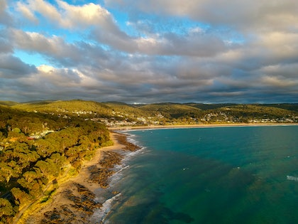 (CreativeWork) A Cloudy Sunrise in Lorne by Stephanie Tuckfield. photograph. Shop online at Bluethumb.