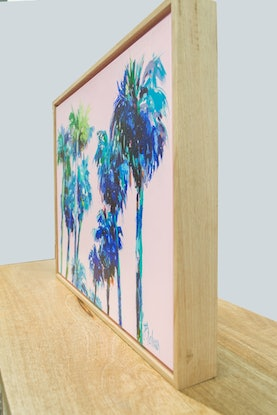 Blue palm trees on a pink background
