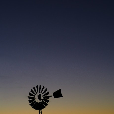 (CreativeWork) Windmill Sunsets and Crescent Moons by Indya Blake. Photograph. Shop online at Bluethumb.