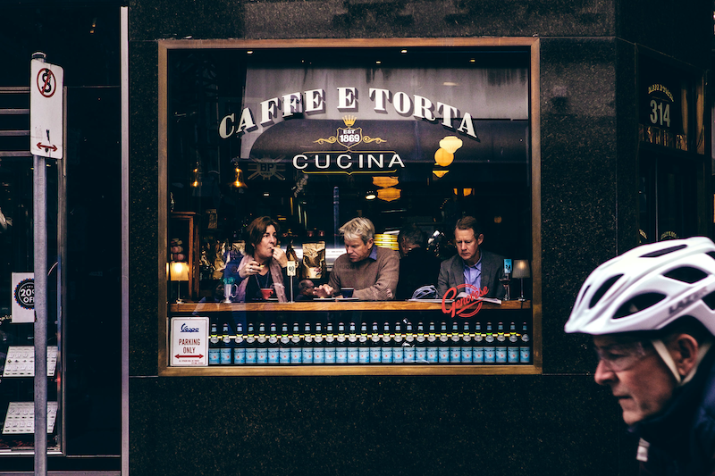 (CreativeWork) Three coffee drinkers and a cyclist Ed. 1 of 10 by Brent Lukey. Photograph. Shop online at Bluethumb.