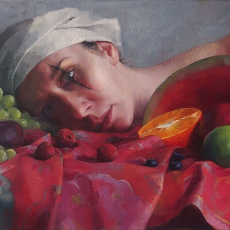 woman laying down with fruit and makeup on