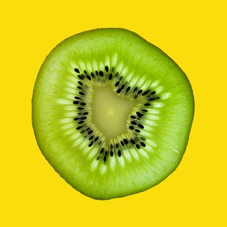 (CreativeWork) Kiwi Fruit on Yellow Ed. 1 of 50 by Nadia Culph. Photograph. Shop online at Bluethumb.