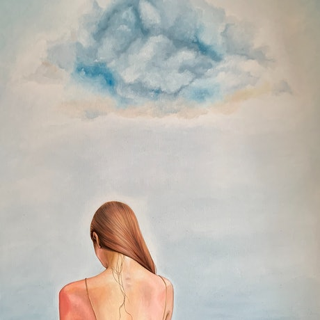 The back of a red headed woman standing still in dark water with a cloud in the sky above