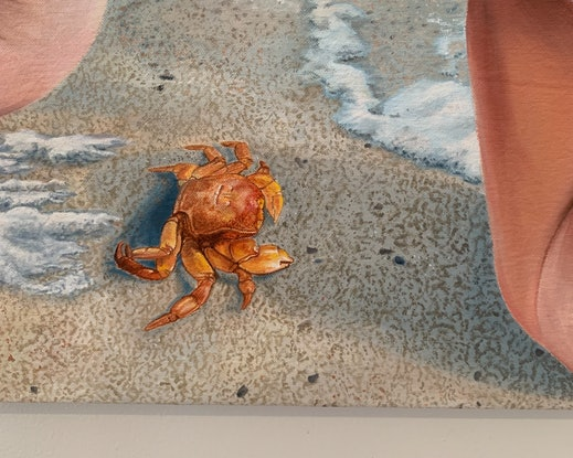 Nude woman on shore with crab and sea foam