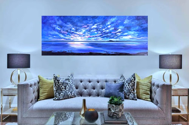 Large painting of a dramatic sunset sky reflected in the calm water of the bay.