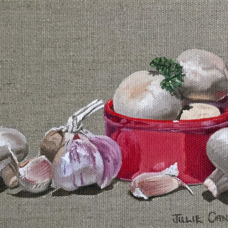 Still life oil painting of mushrooms with garlic and parsley with a red ramekin painted on primed raw linen.