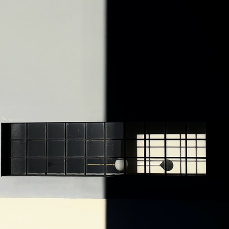 (CreativeWork) On shadows and architecture  by Ed Fetahovic. Photograph. Shop online at Bluethumb.