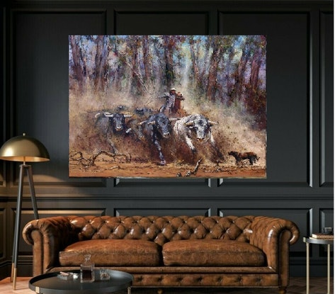 Action painting of Jackeroo on horseback with whip herding charging  cattle with Australian gum trees  and dust in background.