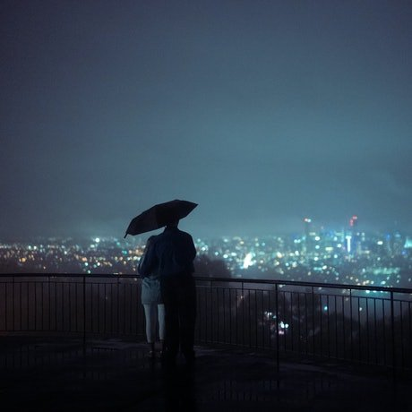 A couple looking over the city