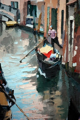 Boats sailing down a Venice canal