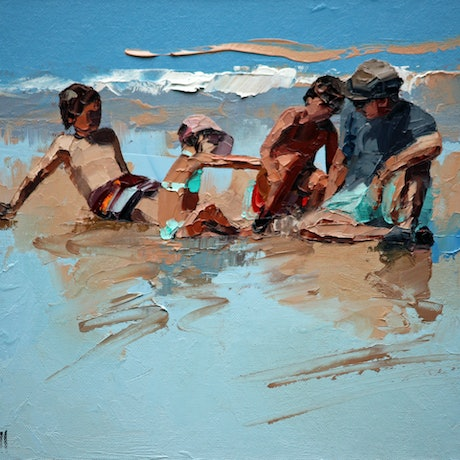 Dad and children playing at beach