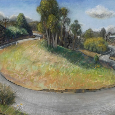 Curved, windy road on fine day