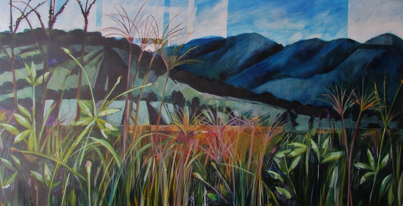 dark blue mountains in background, foreground pink and ornage grass and green leaves