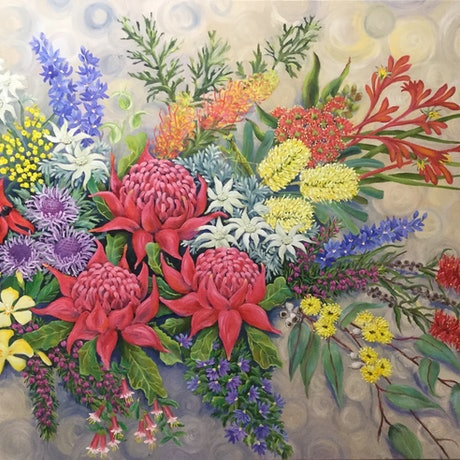 An exuberant colourful bunch of Australian Native flowers with a praying mantis among the blooms.