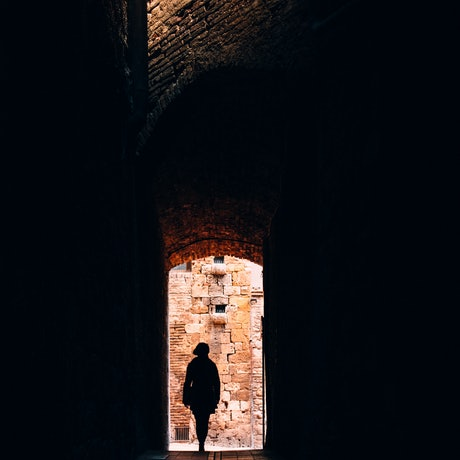 Person in old Italian alley
