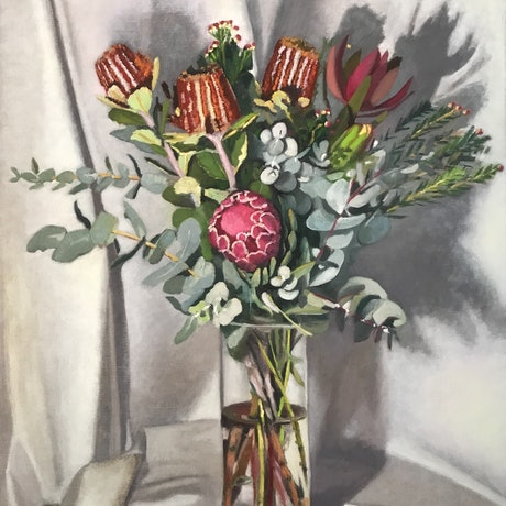 Large bunch of native flowers in glass vase