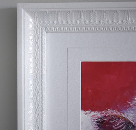 Oil painting of a white cow on a red background. It has a white frame to match.