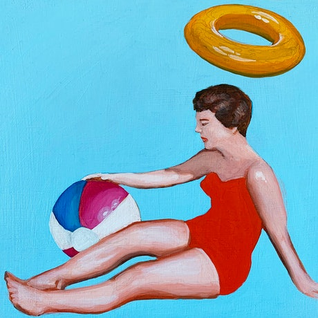 Woman on a blue back ground holding a beach ball with inflatable ring in the air