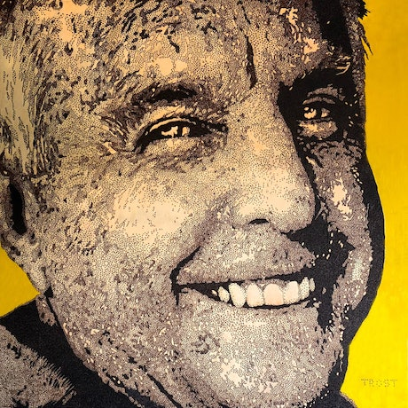 Smiling male face on yellow background