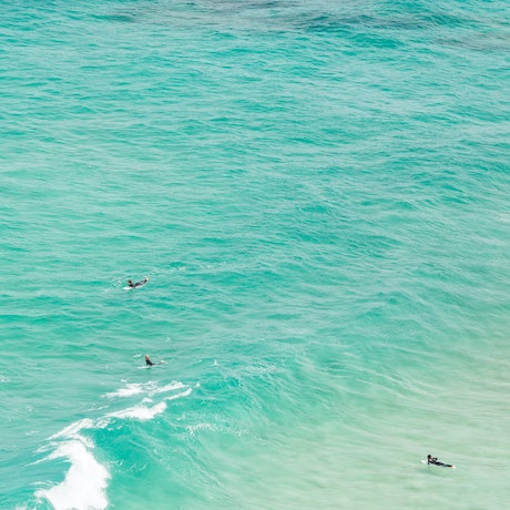 (CreativeWork) Three surfers Ed. 1 of 5 by Wendy Philip. Photograph. Shop online at Bluethumb.