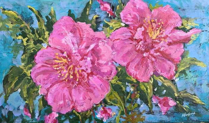 Bright pink camellias on a textured background.
