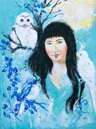 Beautiful young woman surrounded by birds