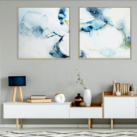 Navy and blue minimal abstract diptych on white background with touches of yellow green