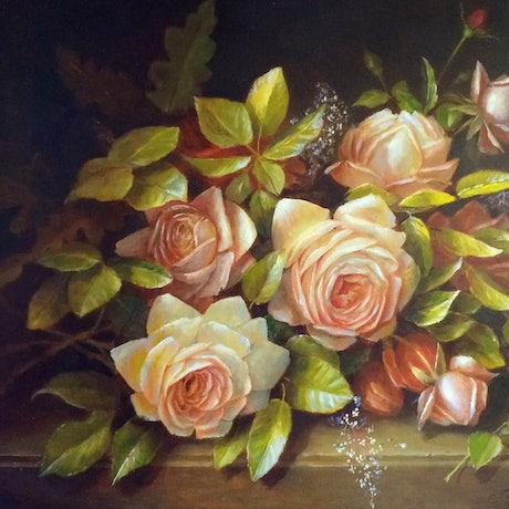 A bunch of soft pink roses laying on a stone slab.