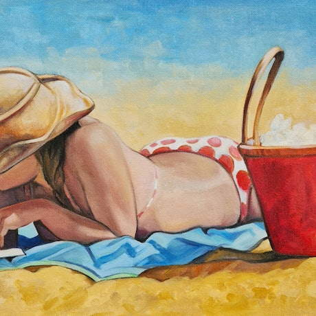 Young woman with book reading at the beach on summer's day