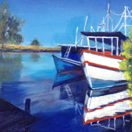 boats moored on river edge