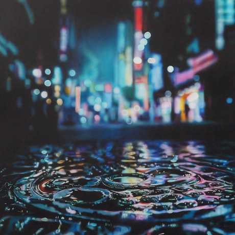 City lights at night wet reflections.