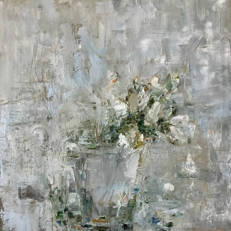 White flowers in a grey vase on a grey / blue background