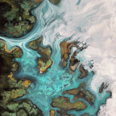 aerial view of turquoise sea flowing through rocks